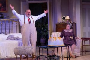David Schramm (left) as Big Daddy and Charlotte Booker (right) as Big Mamma in Cat on a Hot Tin Roof