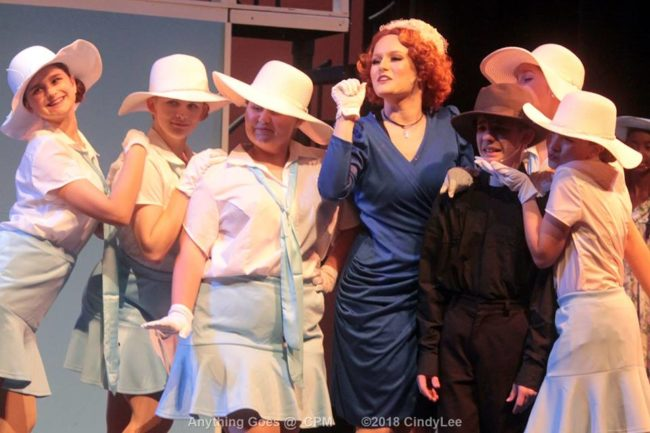 Reno Sweeney (center left,, Hannah Sikes) with Moonface Martin (center right, Dylan Morrison) and her Angels (surrounding, Chloe Davies, Emily Davis, Rose Glennon, Gwendolyn Bohn, Sofia Alvarez, Grace Glennon) in Anything Goes