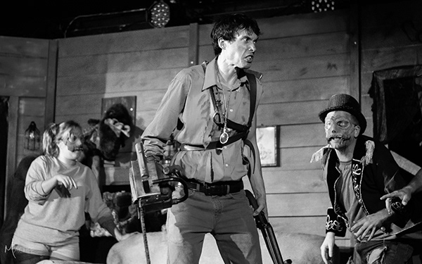 Ellen Manuel (left) as Kandarian Demon with Michael Bliss (center) as Ash, and Rance Denton (right) as MC Kandarian Demon in Evil Dead: The Musical