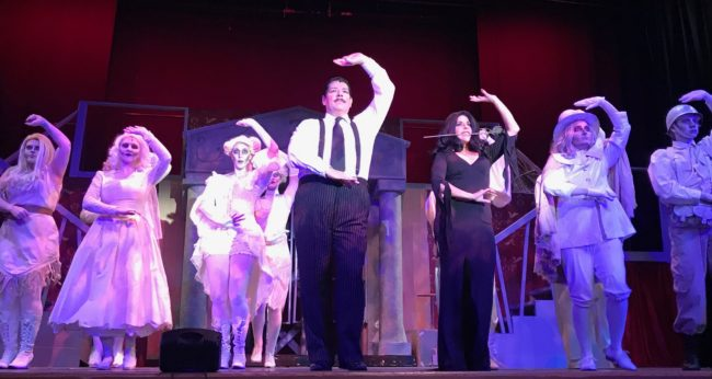 Vincent Musgrave (center left) as Gomez Addams and Santina Maiolatesi (center right) as Morticica Addams with the Addams Ancestors