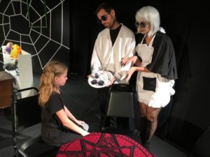 Ava Nicholas (left) as Coraline with Matt Baughman (center) as other Father and Jen Bevarelli (right) as other Mother
