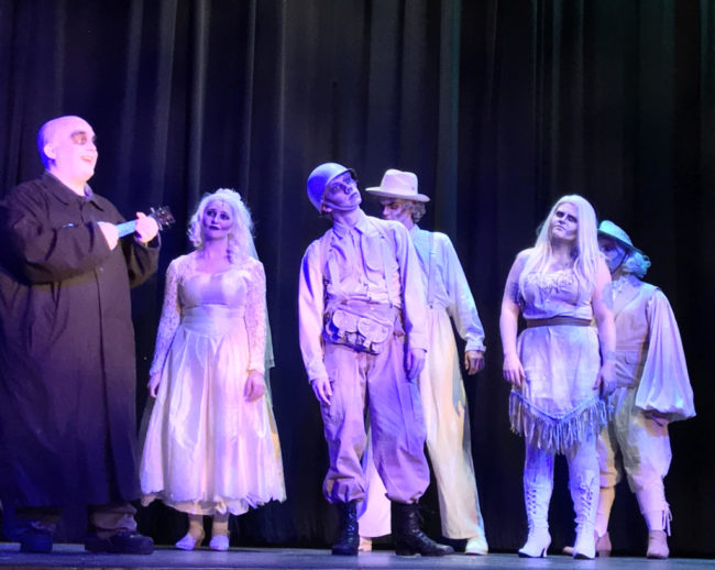 (L to R) Michael Crook as Uncle Fester, and Addams Ancestors Maggie Mellott, Justin Moe, Billy Luzier, Parker Bailey Steven, Derek Anderson