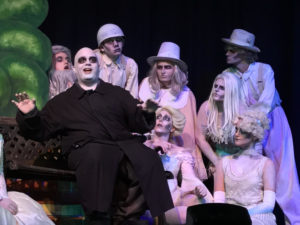 Michael Crook as Uncle Fester, and Addams Ancestors (L to R) Matt Sorak, Justin Moe, Atticus Boidy, Beth Cohen, Parker Bailey Steven, Billy Luzier, and Abby McDonough