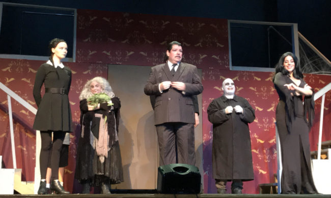 Heather Moe as Wednesday Addams, Caitlin Grant as Grandma Addams, Vincent Musgrave as Gomez Addams, Michael Crook as Uncle Fester, and Santina Maiolatesi as Morticia Addams