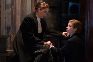 A grieved Constance (Holly Twyford) consoles her son Arthur (Megan Graves) in Shakespeare's King John. On stage at Folger Theatre, October 23 – December 2, 2018