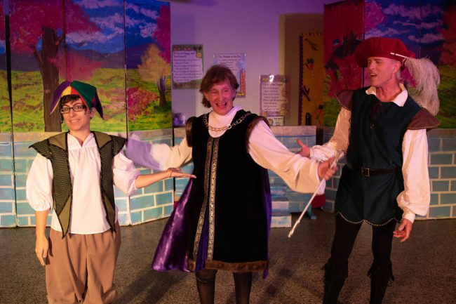 Mel Tillery (left) as Jester, Emma Hawthorn (center) as King Sextimus, and James Fitzpatrick (right) as Minstrel