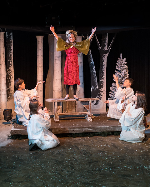 Claire Gunthert (center) as Magda and the children of the pageant. Photo by Harvey Levine