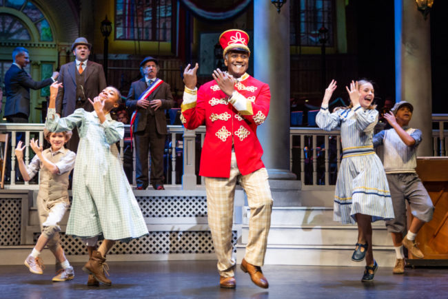 Norm Lewis (center) as Prof. Harold Hill and the River City Children in The Music Man Photo: Jeremy Daniel