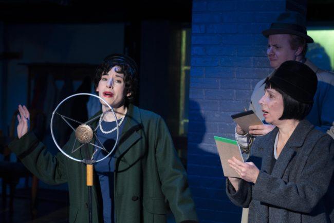 Bette Cassatt (left) as Grace Fryer, Julie Herber (right) as 'Sob Sister' Nancy Jane Harlan and J.D. Sivert (background) as Reporter Jack Youngwood in Radium Girls. Photo by Joe Williams.