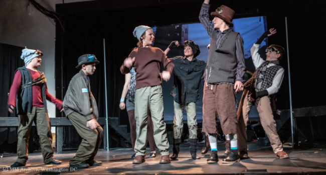 Cody Yeatman (center left) as Oliver and Cole Edelstein (center right) as the Artful Dodger in Oliver! Photo: Mark McLaughlin Photography