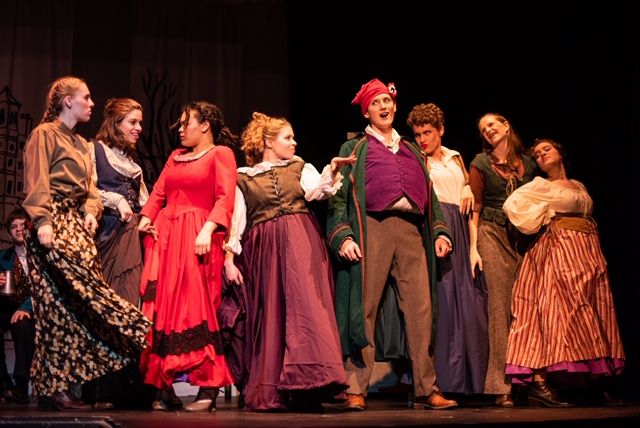 Lauren Foley (center left) as Madam Thènardier and Sean Fitch (center right) as Thènardier in Les Miserables. Photo: Alyssa Bouma