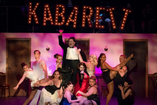 Tommy Malek (center) as the Emcee and the company of Cabaret. Photo: Stasia Steuart Photography