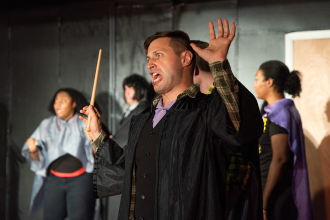 "Rob Tucker as J. Finch Fletchly in his ""petrified place"" in PUFFS. Photo: Matthew Peterson"
