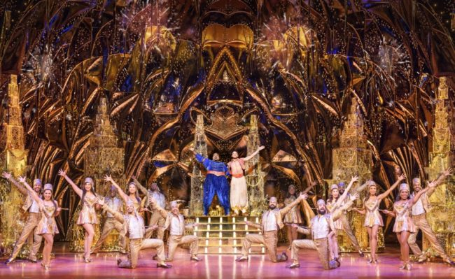 Major Attaway (center left) as Genie and Clinton Greenspan (center right) as Aladdin and company in Disney's Aladdin. Photo: Deen van Meer