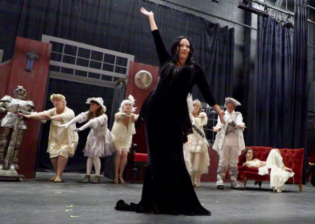 Michele Guyton (center) as Morticia Addams and The Ancestors. Photo: Tom Littlejohn