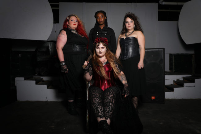 The cast of Lizzie with Guerrilla Theatre Front with Parker Bailey Steven (seated center) as Lizzie Borden and Siobhan Beckett (left) as Bridget, JacQuan Knox (center) as Alice, and Caitlin Weaver (right) as Emma Borden. Photo: Shealyn Jae Photography