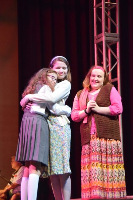 Maeve Acerno (left) as Matilda with Emily Signor (center) as Miss Honey and Mara Jade Beaumier (right) as Mrs. Phelps in Matilda at CPM