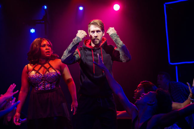 Ashley Johnson-Moore (left) as Rachel Marron and Justin Calhoun (right) as The Stalker in The Bodyguard. Photo: Jeri Tidwell.