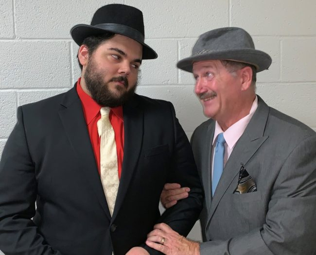 Matthew Price (left) and Good Old Reliable Nathan Detroit (Jim Morgan, right) in Guys & Dolls