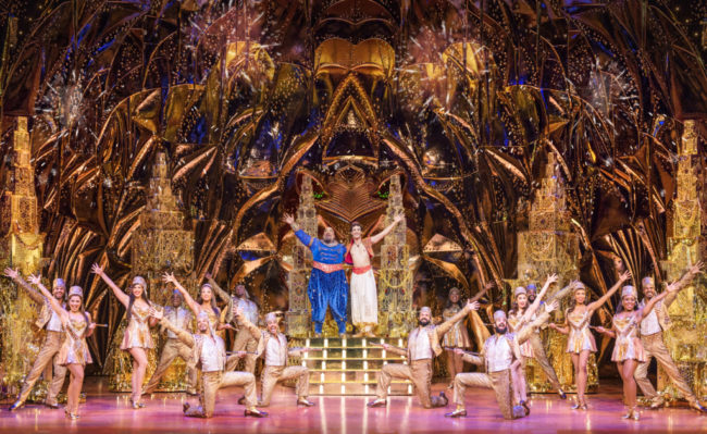 Korie Lee Blossey (center) as Genie with the North American Tour of Aladdin. Photo: Deen van Meer.
