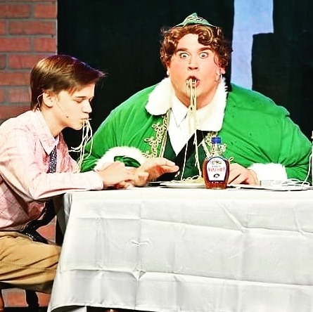 Adrien Amrhein (left) as Michael and Dickey Mahoney (right) as Buddy the Elf.