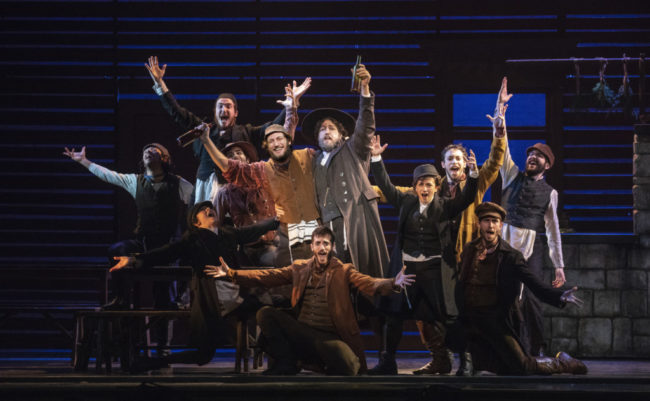 Yehezkel Lazarov (center left) as Tevye, and Jonathan Von Mering (center right) as Lazar Wolf & the Cast of Fiddler on the Roof. Photo: Joan Marcus