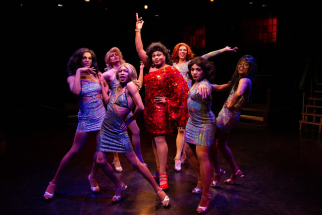 DeCarlo Raspberry (red, center) as Lola and The Angels in Kinky Boots. Photo: Jeri Tidwell Photography