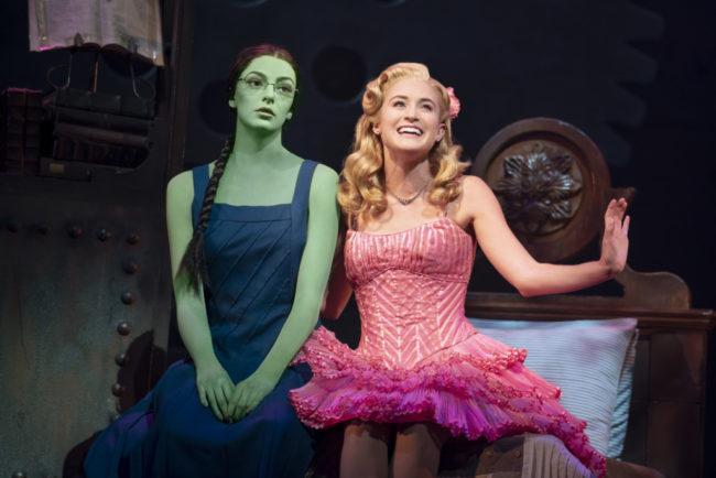 Talia Suskauer (left) as Elphaba and Allison Bailey (right) as Glinda. Photo: Joan Marcus
