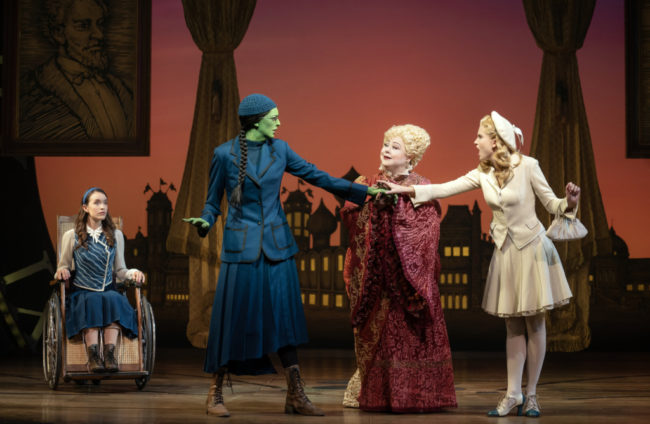 L to R: Amanda Fallon Smith as Nessarose, Talia Suskauer as Elphaba, Sharon Sachs as Madame Morrible, and Allison Bailey as Glinda in Wicked. Photo: Joan Marcus.