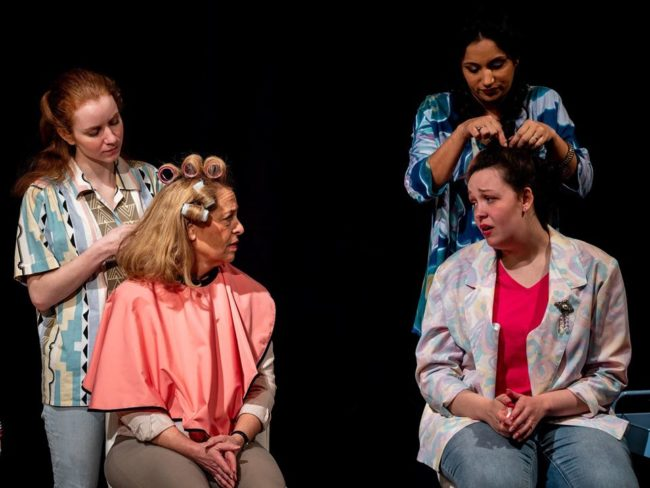Robin Roper (left, standing) as Annelle, Jill E. Goodrich (left, seated) as M'Lynn, Divya Pereira (right, standing) and Rachel Heney (right, seated) as Shelby in Steel Magnolias.