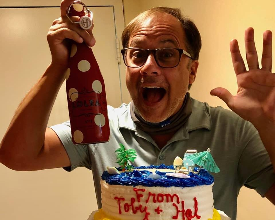 Celebrating his 52nd Birthday- Mark Minnick and a cake. And a bottle.